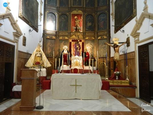 Traslado de los titulares de San Roque y la Virgen de la Sierra al altar mayor // Carlos Iglesia